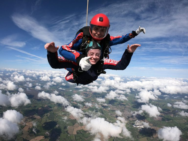 Thumbs up skydiver